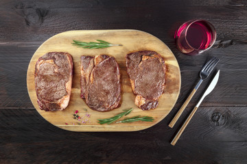 Cooked meat on rustic textures with wine and copyspace
