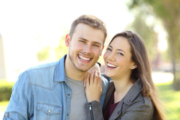 Couple posing with perfect smile and white teeth