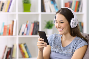 Girl listening to music on line on a smart phone
