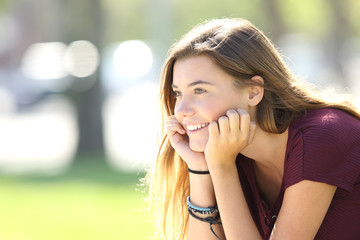 Happy teenager looking forward in a park