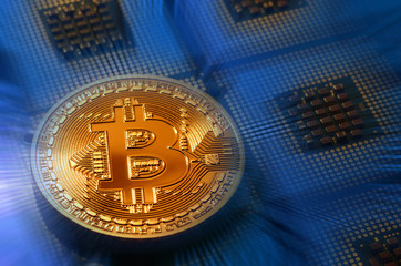 close up of phisical bitcoin over computer cpu. background and business concept image.