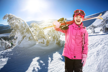 child skier skiing in the mountains