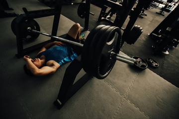 Gym workout accident or overtraining. Weight lifting accident. Accident on gym workout concept.