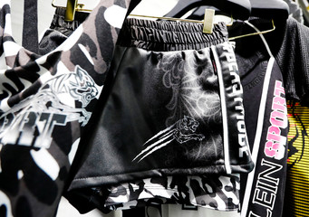 The pants and shirts with a Philipp Plein tiger logos are pictured in their shop in Berlin