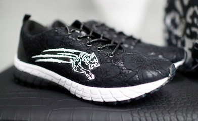 Shoes with a Philipp Plein tiger logo are pictured in their shop in Berlin