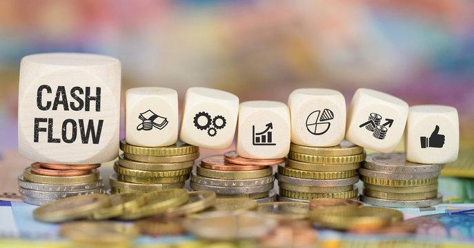 Cash Flow / Münzenstapel mit Symbole