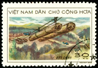 Ukraine - circa 2018: A postage stamp printed in Vietnam shows Transportation of wood by means of suspension cables. Zipline. Series: Transport. Circa 1968.