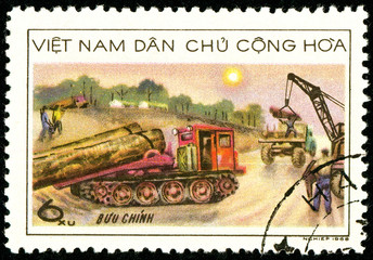 Ukraine - circa 2018: A postage stamp printed in Vietnam shows Timber - hauling lorries. Work on the assembly of wood. Series: Forestry. Circa 1968.
