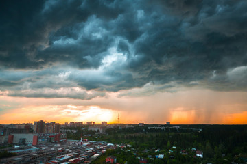 View of the buildings in the city of Izhevsk at sunset with dramatic sky