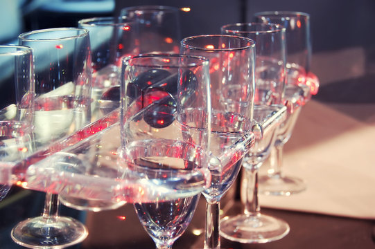 several champagne glasses ready to use in the wedding car. Closeup