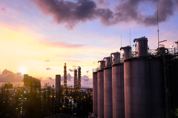 silos in petrochemical industry plant at  sunrise