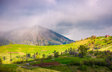 rain over the rural fields on hills. beautiful springtime landscape of Carpathian mountains.