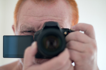 New camera with a folding touch screen using a mirror. Selective focus. Selfie, photograph that one has taken of oneself typically with smartphone and uploaded to a social media website.