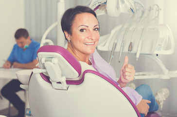 woman in medical center thumbs up