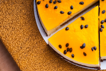 Sliced passion fruit cheesecake