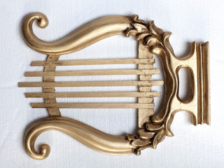 Gold colour antique mouth harp, white background