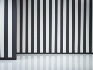 Black and white striped walls and reflective floor