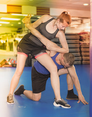 Active woman with trainer  on the self-defense course
