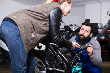 Man worker offering help to female customer