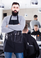male hairdresser showing his workplace and tools at hair salon