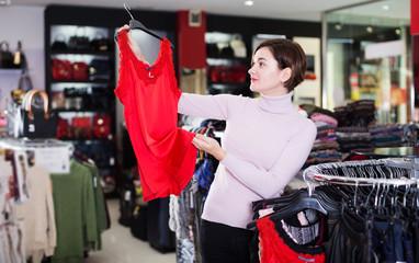 Woman choosing pretty dress