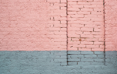 Pink and gray painted brick wall with a permanently closed door