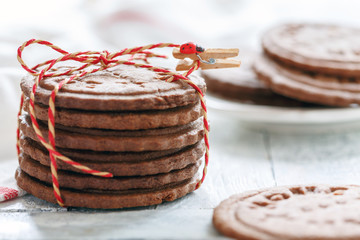 Stack of chocolate cookies tied with a cord.