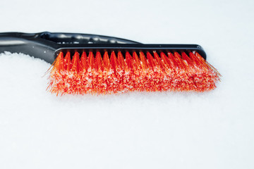 orange snow brush for car, snowflakes background