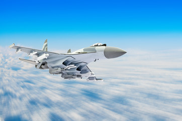 Military fighter aircraft at high speed, flying high in the sky.