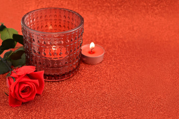 Red romantic background stock images. Red rose with candle on a red background. Valentines Day romantic background