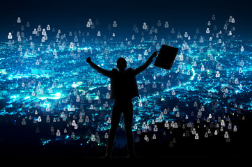 silhouette of businessman with document bag in hand raise arms up because success in business over night city with people icon  background