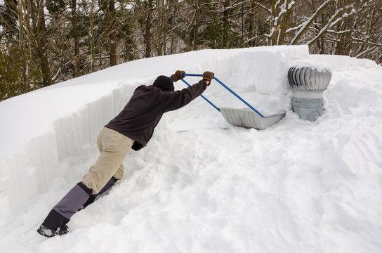 Shoveling snow off roof