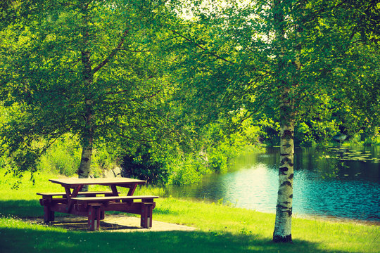 Rest place in park, picnic table in peaceful surrounding