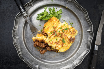 English shepherds pie as top-view on a pewter plate