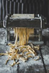 Preparing homemade tagliatelle on the table,selective focus