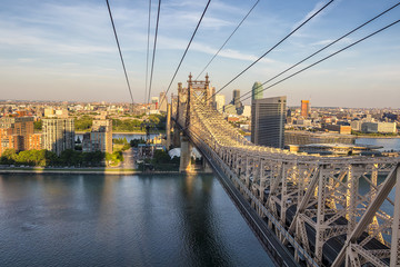 Aerial view of Ed Koch Queensboro Bridge looking to Roosevelt Island at sunset, New York City