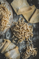 Italian traditional tagliatelle on the wooden table,high angle