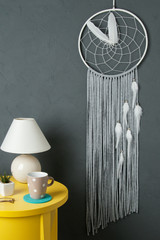 Gray white dream catcher on gray