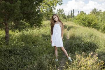 Caucasian girl standing in field of grass