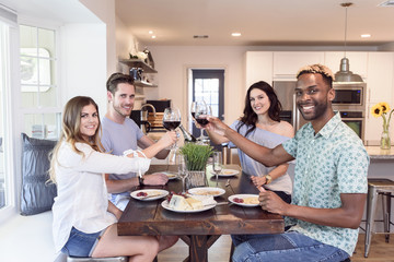 Portrait of friends toasting with red wine