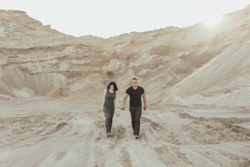 Middle Eastern couple walking in the desert