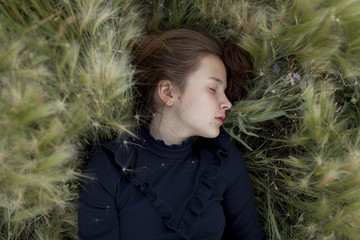 Caucasian girl laying in field