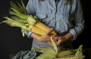 Close up of Caucasian woman holding corn