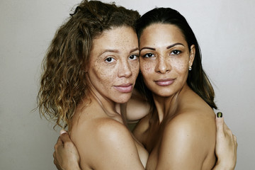 Close up of mixed race women hugging