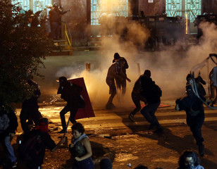 Police clash with protesters during a protest against fare hikes for city buses in Sao Paulo