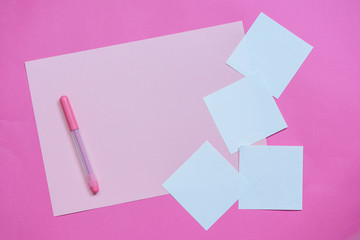 Paper pink background with empty notes. The concept of Valentine Day or bloggers. Flat Lay, top view