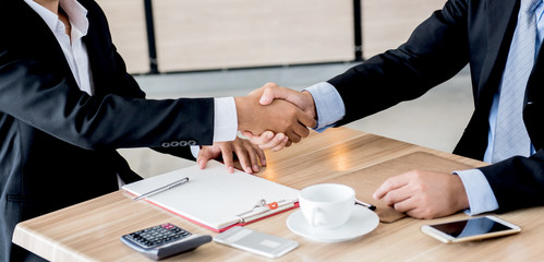 handshake for business and teamwork for achievement KPI and goal