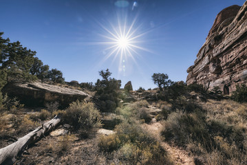 Sun in blue sky over desert, Moab, Utah, United States