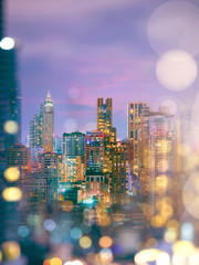 Abstract blurred and bokeh background of city skyline at night.