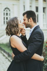 Portrait of smiling Caucasian couple kissing